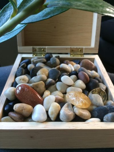 box of polished rocks